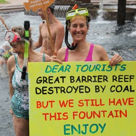 Sydneysiders went snorkelling in Hyde Park fountain today in protest of the planned expansion of coal ports on the Great Barrier Reef.