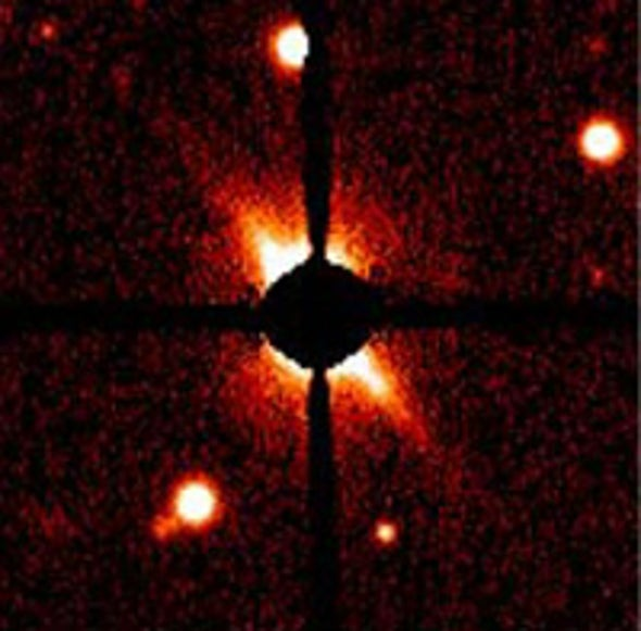 Nearby Star Is Surrounded by Stuff of Planets