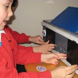 Children use puzzle box