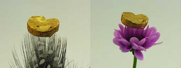Lightest Gold Nugget Ever—20 Carats—Sits On A Feather