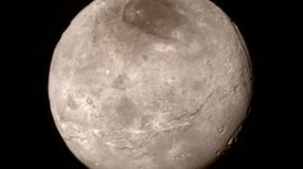 New Horizons Delivers First Close-Up Glimpse of Pluto and Charon