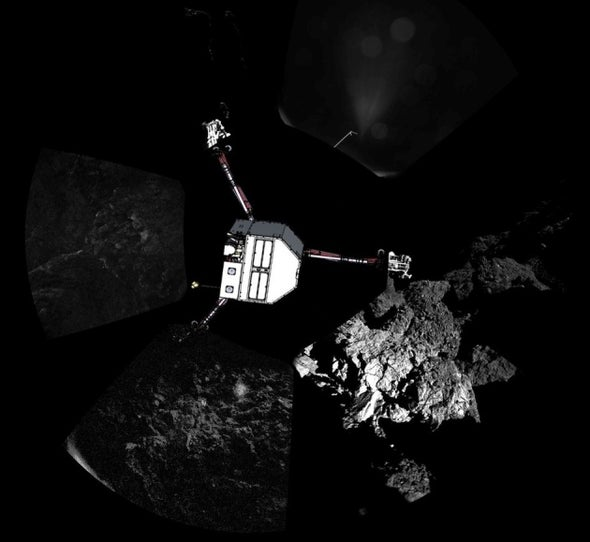 Comet Lander Stuck against Bottom of Shady Cliff