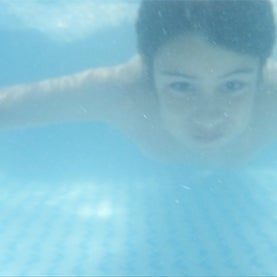a boy holds his breath under water, breath holding, underwater