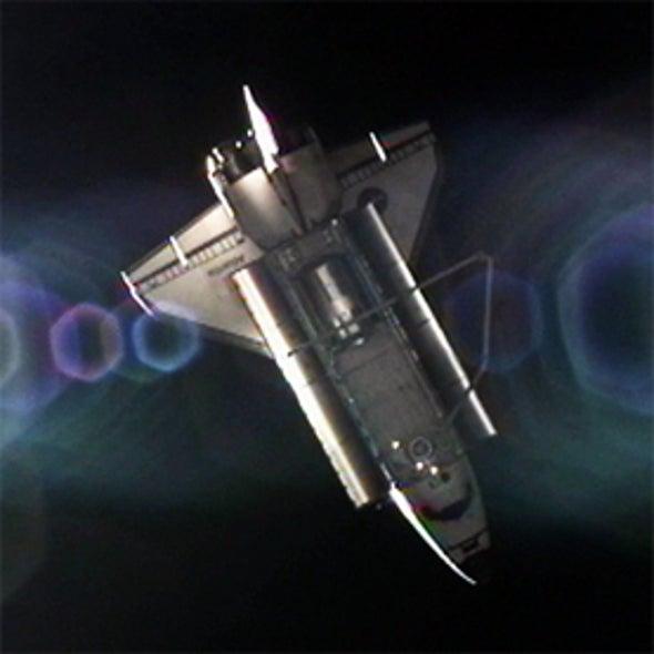 Last Shuttle Astronauts Bid Historic Farewell to Space Station