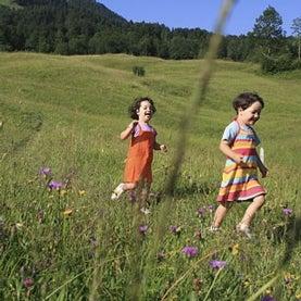 girls-running-through-field