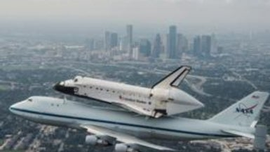 Space Shuttle <i>Endeavour</i> Leaves Houston on Last Journey West