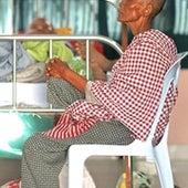 Mrs. Lai Koen sits