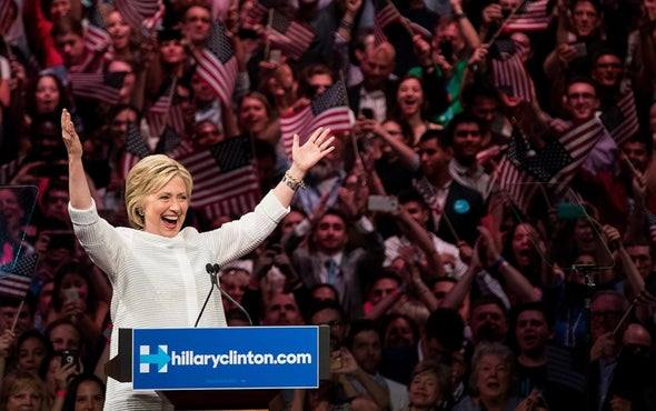 Clinton Claims Nomination, Blasts Trump on Climate