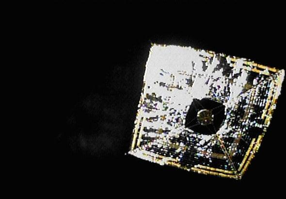 Spring-loaded camera photographs IKAROS's deployed solar sail