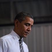 Obama Warns of