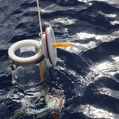Point water sampler being lowered into the Pacific Ocean to 200 meters to collect a water sample deep in the water column.