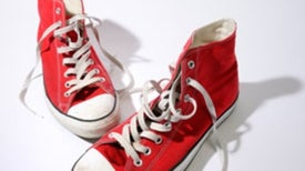 Gaining Status with Red Sneakers