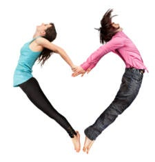 acrobatic couple making heart shape with their bodies