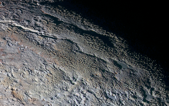 Scientists Explain Pluto's Skyscraper-Size Ice Blades