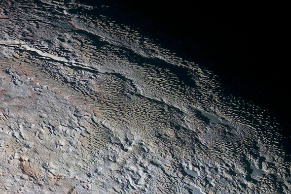 Scientists Explain Pluto's Skyscraper-Size Ice Blades
