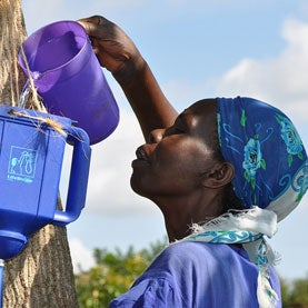 woman-pouring-water-into-lifestraw