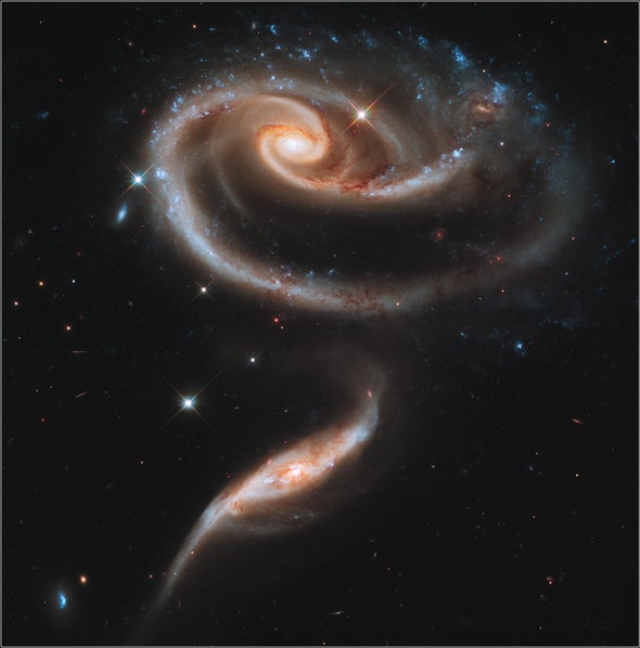 A rose is a...galaxy collision: Hubble sends the people of Earth a flower on its 21st anniversary