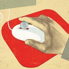 Feeding a quarter into a mouse on a desktop.