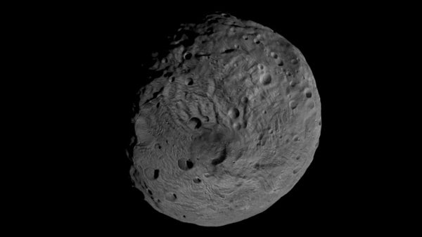 Asteroid Vesta Flyover Reveals a Craterful of Mysteries
