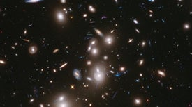 Astronomers Use Gravitational Lenses to Push Hubble Past Its Limits