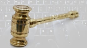 gavel and computer keyboard composite