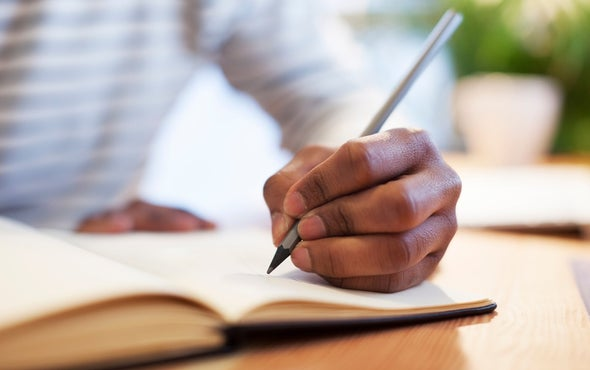 What causes some people to be left-handed, and why are fewer people left-handed than right-handed?