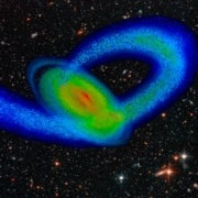 Star-Crossed: Milky Way's Spiral Shape May Result from a Smaller Galaxy's Impact