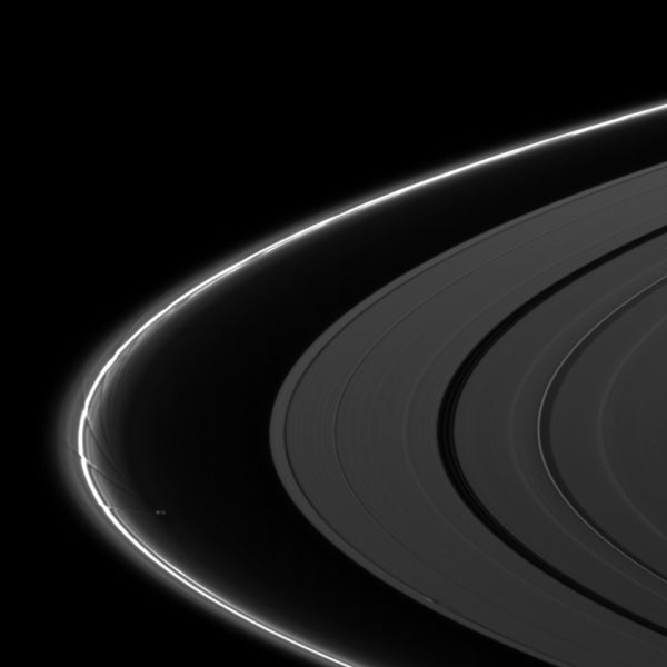 Close-up view shows Saturn's moons reshaping the planet's rings