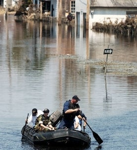 Sailors search a flooded New Orleans neighborhood.