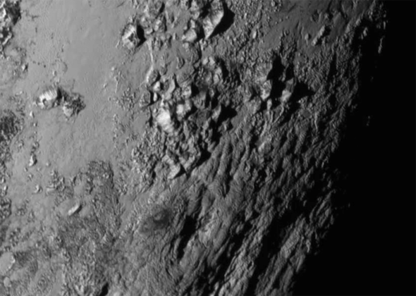 New Close-Ups of Pluto and Charon Present Puzzle for Scientists