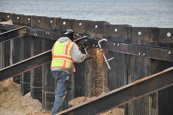 Sea Walls May Be Cheaper Than Rising Waters