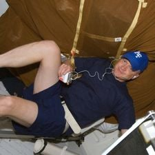 astronaut working out with an iPod