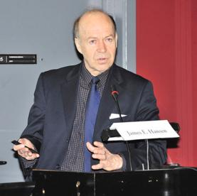 James Hansen speaking at a podium at the Energy Crossroads Conference in Denmark