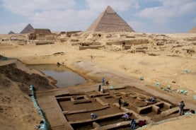 image of archaeological excavation site with pyramid in background