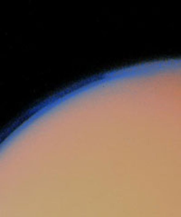 Astronomers Spy Surface Ice Through Titan's Haze
