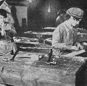 Airplane manufacture relied on skilled carpentry. Here, women workers in a British factory, 1917. Note the brace-and-bit drill and other hand tools on the bench.