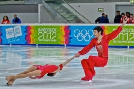 image of two figure skaters dressed in red