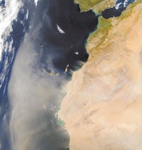Sandstorm blows particulates out from the Sahara Desert in Africa (<I>landmass at right</I>) over the Canary Islands in the Atlantic Ocean. The storm occurred in February 2001.