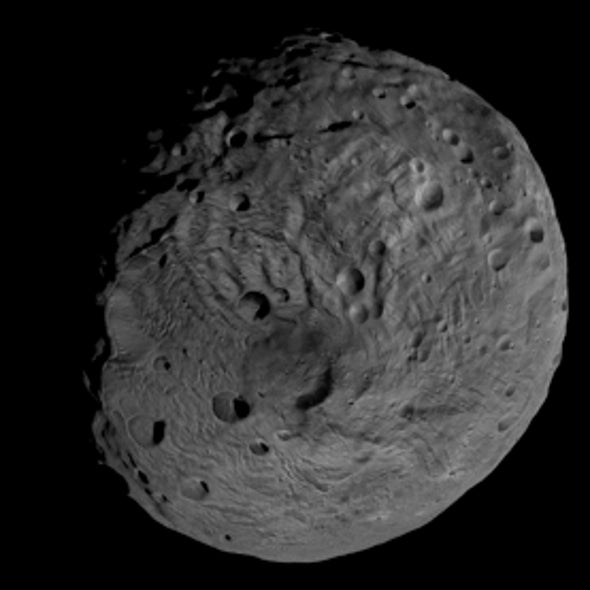 Ball Wet: Massive Asteroid Vesta Harbors Scant Frozen Water at Surface